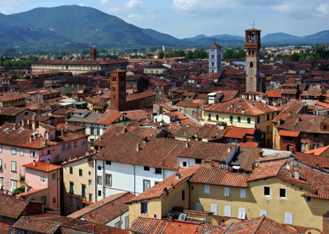 Lucca is a majestic Tuscan city famed for its fully-intact Renaissance walls and medieval clock tower