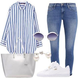 kemeja longgar gari biru, celana jeans, tas silver, pearl studs, sneakers putih
