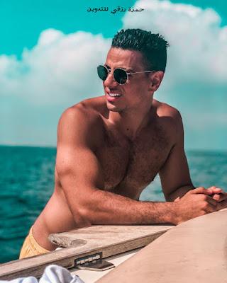 الفورمة تاع طه إيسو في البحر ويضع نظارات شمسية وجسم جداب