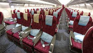 Nyamanya menggunakan Qatar Airways