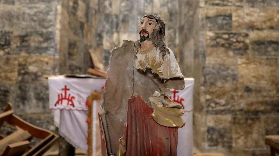 Sagrado Coração de Jesus fuzilado numa igreja de Qaraqosh, sul de Mosul, Iraque.