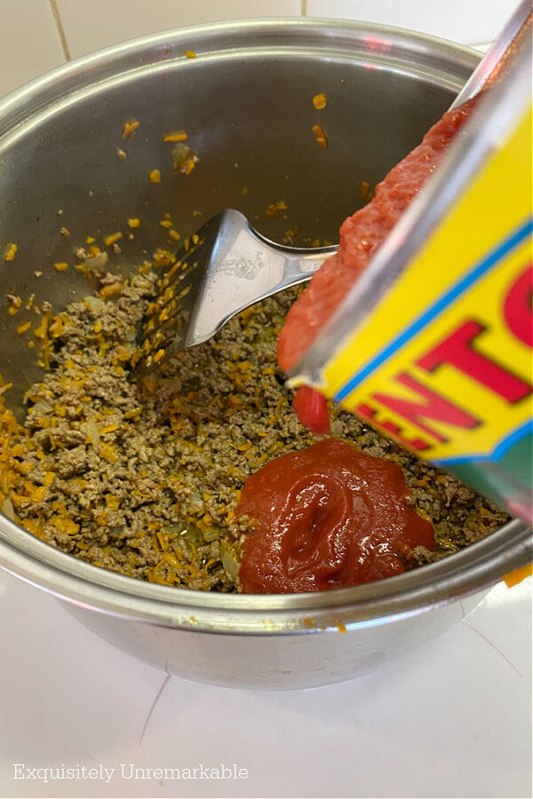 Adding Tomato Puree To Bolognese Sauce