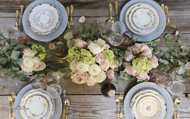 rustic tabletop with flowers and vintage place settings