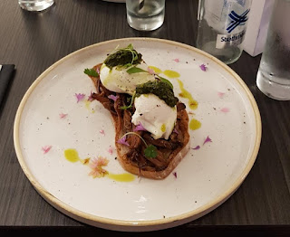 Beef brisket with poached eggs and salsa verde at the 3 Squared Cafe in Manchester