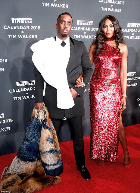 Naomi Campbell shows off her slender physique in shimmery gown