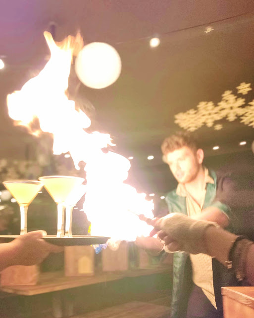 fiery cocktails and girl posting wand at The Cauldron, London