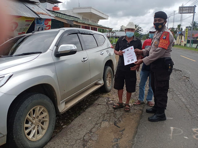 Personil polsek pematang karau Laksanakan ops yustisi di desa bambulung