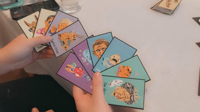 two hands holding matching pair cards
