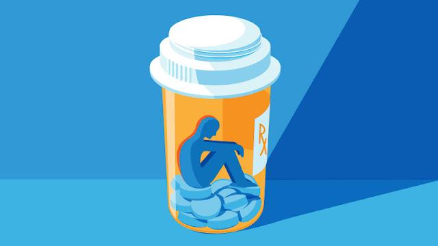 depressed person inside an opioid bottle