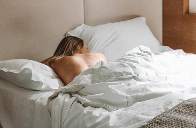 woman sleeping in a relaxing bedroom space