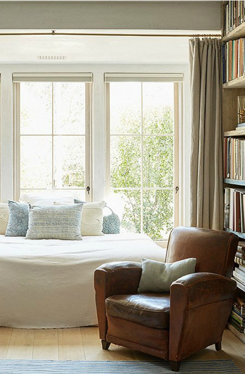 Patina Farm Bedroom With Leather Club Chair And Linen Fabrics.