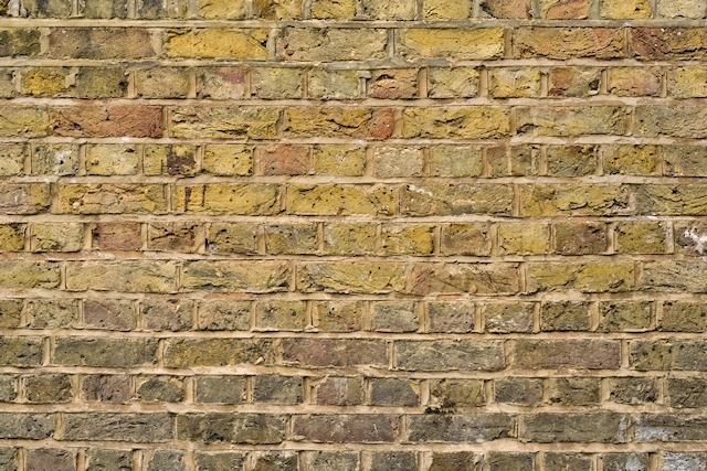 Lightly green moulded brick wall texture