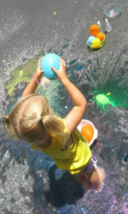 Make colorful rainbows all over the pavement using this easy chalk-filled balloon recipe for play. #chalkart #chalkpaint #chalkfilledballoons #chalkballoonsforkids #sidewalkpaintrecipe #growingajeweledrose #activitiesforkids