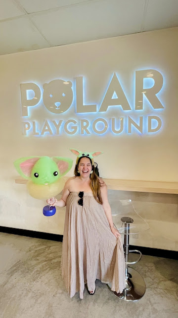 Visiting Polar Playground in Huntington Beach, California and eating oversized Baby Yoda cotton candy.