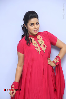 Actress Poorna Latest Stills in Red Dress at Rakshasi First Look Launch  0086.JPG