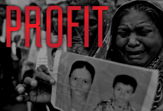 Women holding pictures of the family members they lost in the Rana Plaza tragedy with the word profit written on it.