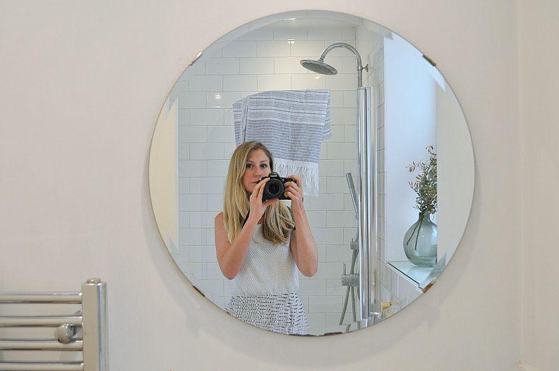 Large bathroom mirror reflects light