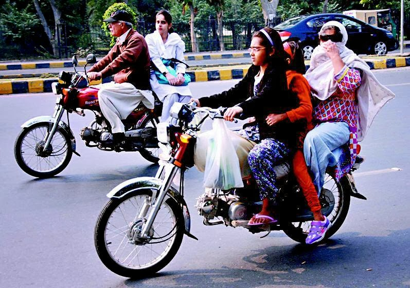 A little girl in Lahore riding bike