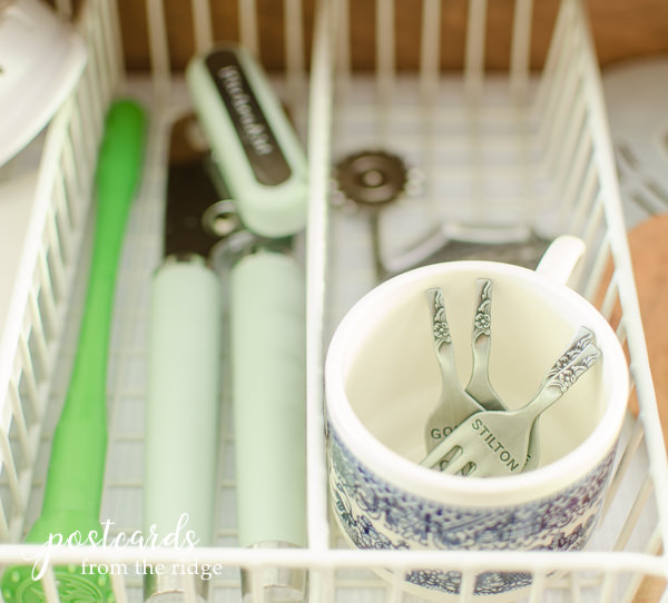 vintage blue and white teacup used to organized kitchen drawer