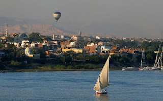 Sailboat and balloon; the Nile River at Luxor