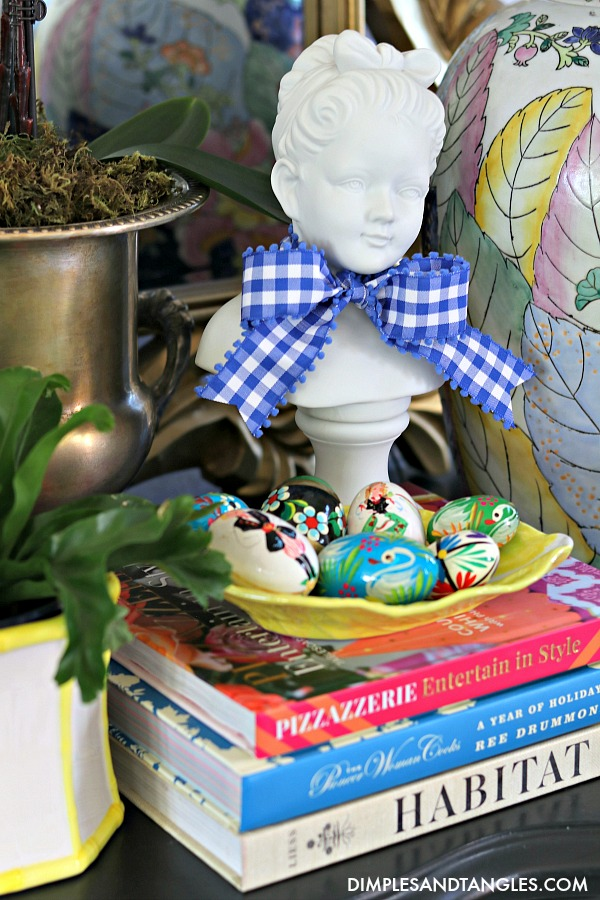Girl plaster bust, gingham ribbon, Polish painted eggs, yellow secla cabbage dish