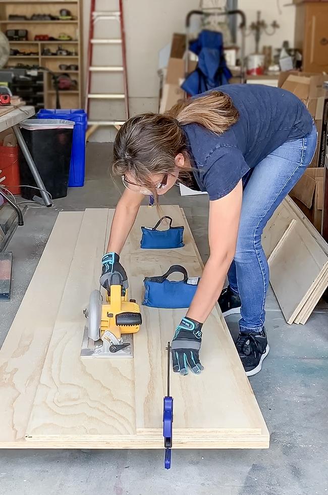 Cristina Garay using a DeWalt circular saw