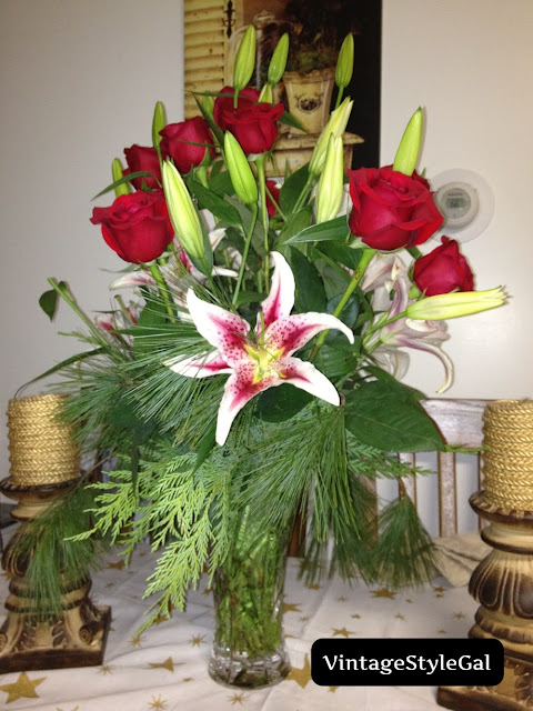 real rose arrangement on dining room table
