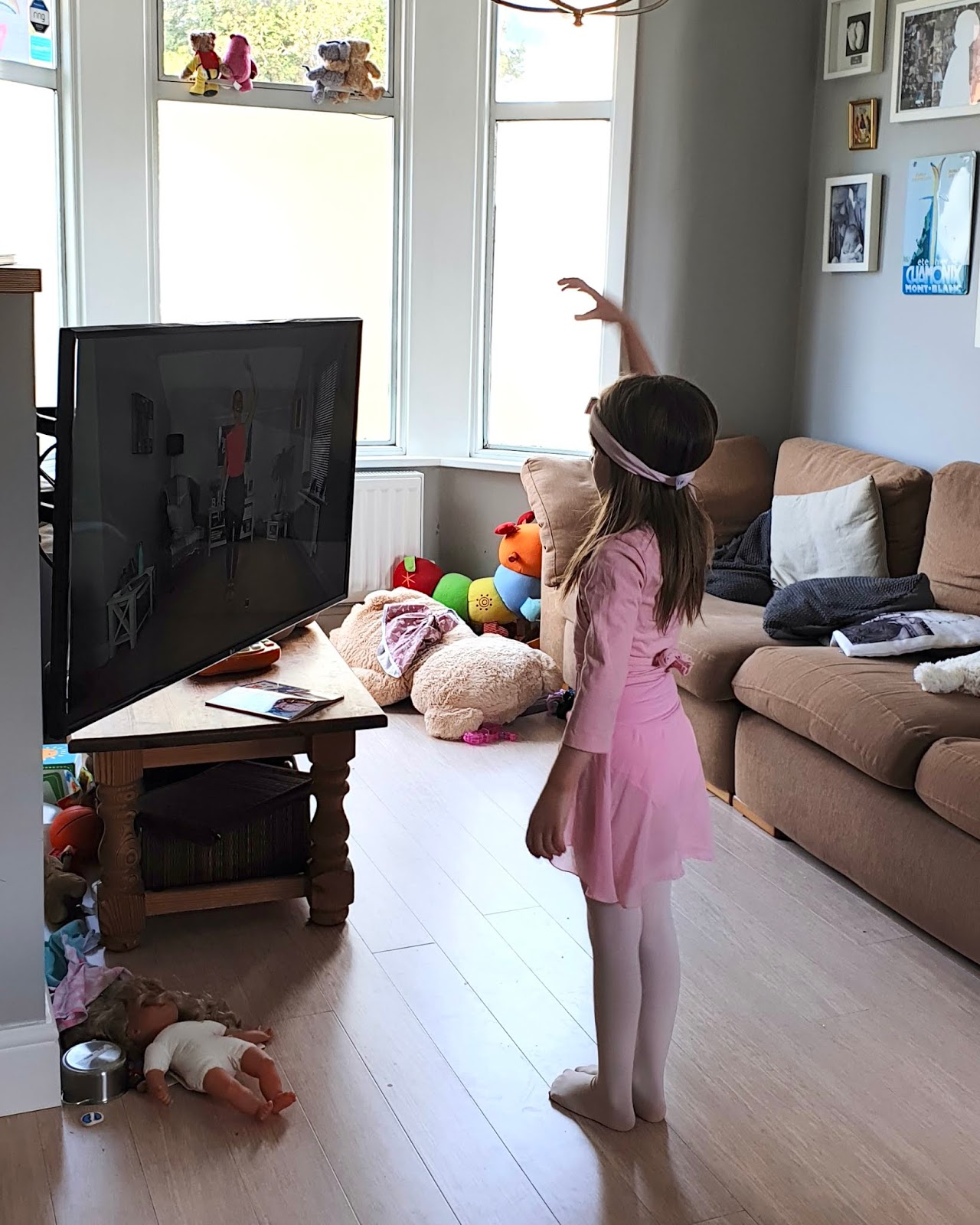 girl doing ballet in front of tv