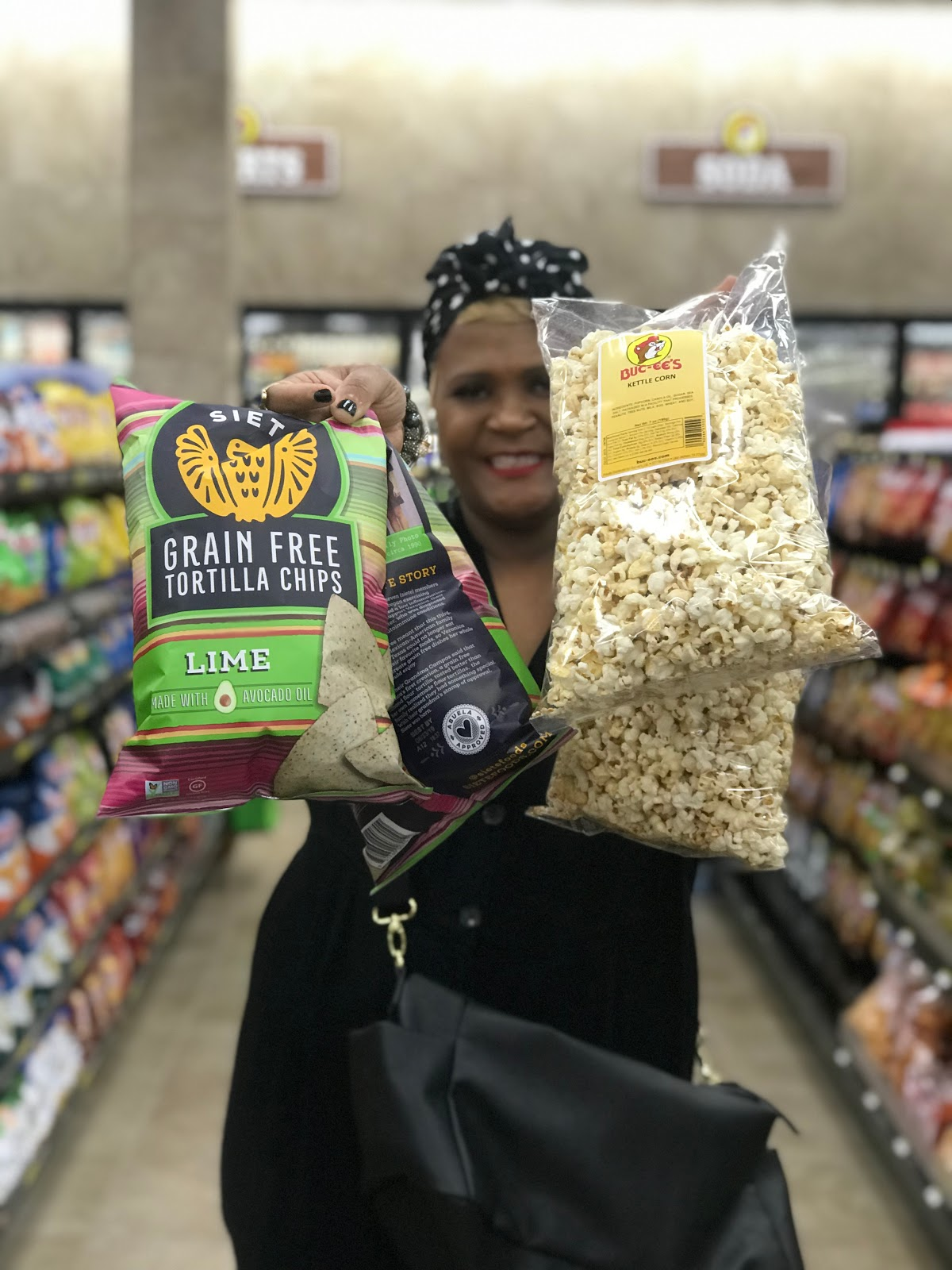 Image: Woman Tangie Bell buying popcorn chips and having fun dancing down the aisles of Buccee's gas station. Seen first on Bits and Babbles Blog