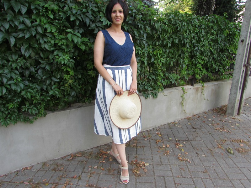 Navy top and striped midi skirt