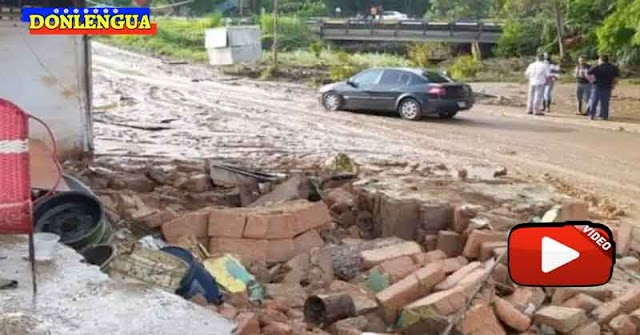 Se desbordó el rio San Pedro en Los Teques y se llevó a ocho personas y varis vehículos
