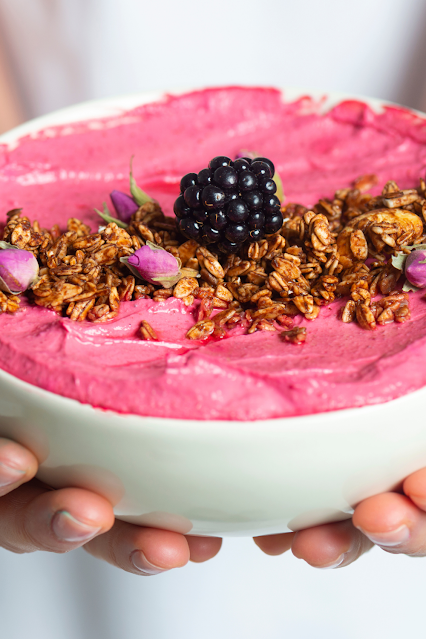 Strawberry smoothie in a bowl garnished with fresh blackberries