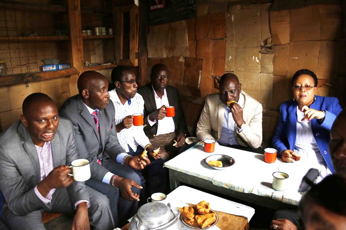 Image result for Dp Ruto eating in kibanda
