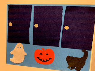 3 flannel doors with flannel ghost, jack-o-lantern, and black cat