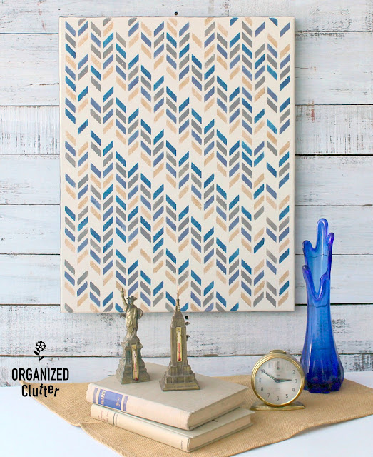 A Thrifted Wall Art Canvas Stenciled With A Herringbone Pattern #dixiebellepaint #stencil #herringbone #wallart #DIY