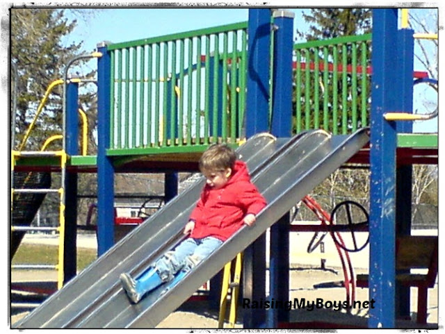 small boy on slide