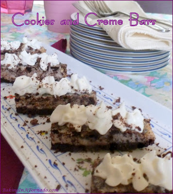 Cookies and Creme Bars: chocolate cookie chunks in a cookies and crème flavored center with a chocolate crust. Serve topped with whipped cream, of course. | Recipe developed by www.BakingInATornado.com | #recipe #dessert