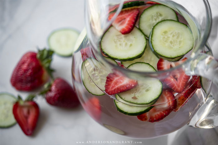 Glass pitcher of strawberry cucumber water