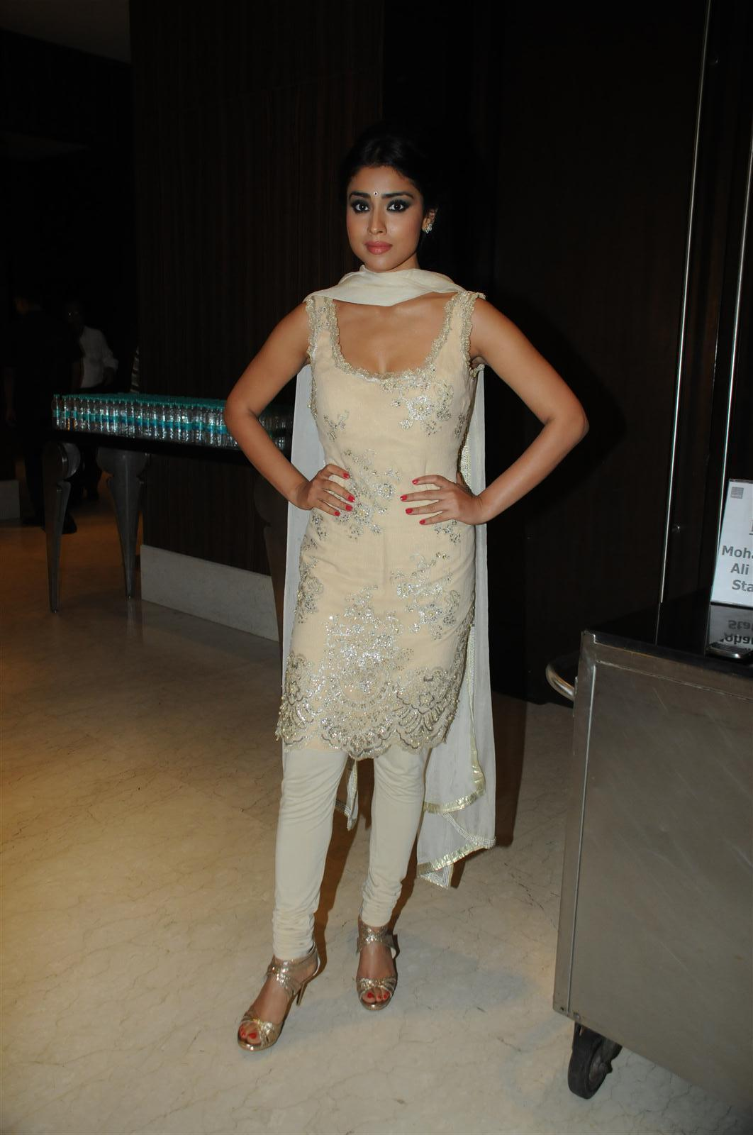 Actress Shriya Saran Sleeveless Photos In Yellow Dress