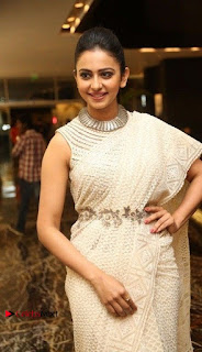 Actress Rakul Preet Singh Stills in White Dress at Winner Pre Release Function  0008.jpg