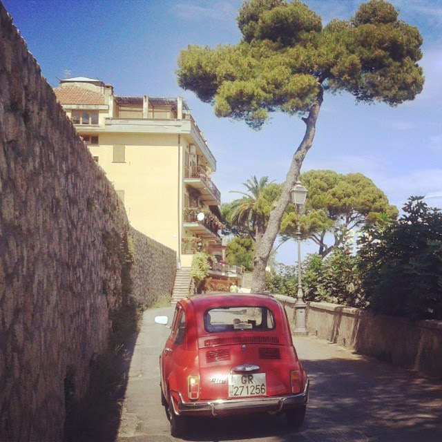 A old red Fiat 500 in Porto Santo Stefano