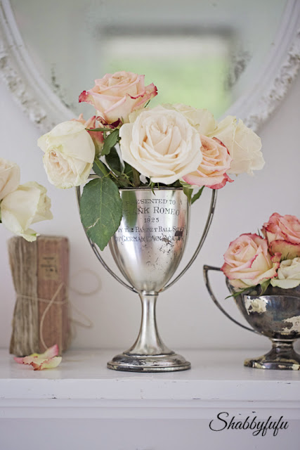 trophy cups with flowers