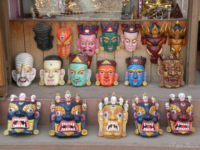 Different types of traditional Nepalese wooden masks on sale