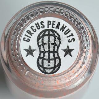 orange peach nail polish with aqua shimmer