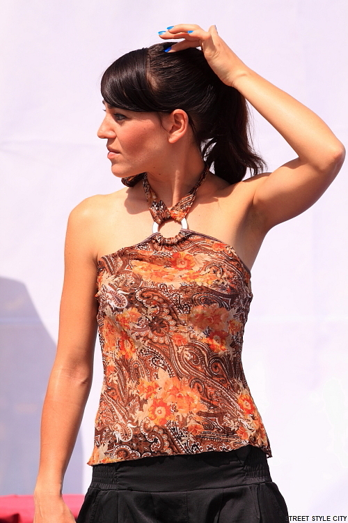 Brunette girl wearing summer top outfit. Street style fashion look