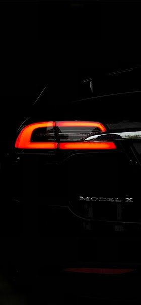 Tail light of black tesla model X vehicle wallpaper