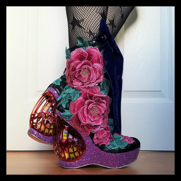 wearing Irregular Choice Maya birdcage boots showing glitter platform, floral applique and heel detail