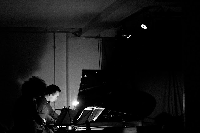 Aisha Orazbayeva and Roderick Chadwick performing Alex HIlls' -verse at Cafe Oto