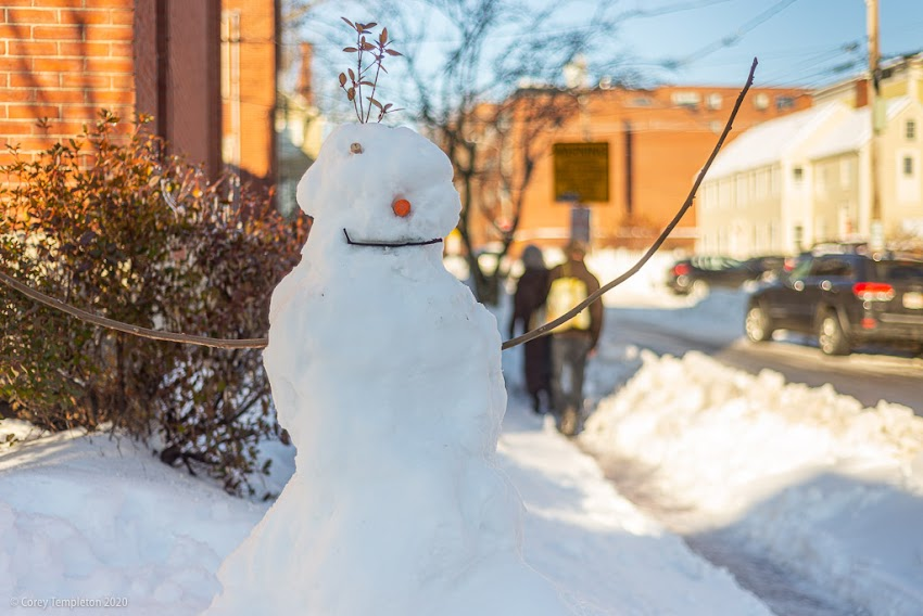 `New Year, Same Neighborhood: A fun stroll through the fresh snow in the West End. Portland, Maine USA January 2020 photo by Corey Templeton. Snowman at Danforth and Winter Streets.