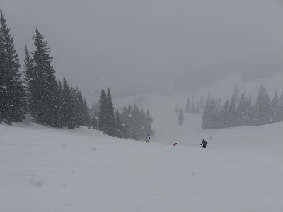 Skiing in dumping snow at Vail